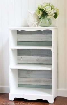 Bookcase makeover using old fence pickets for the backing. Now it's a coasta… Bookcase makeover using old fence pickets for Refurbished Furniture, Repurposed Furniture, Painted Furniture, Refurbished Bookshelf, Space Furniture, Diy Furniture Projects, Furniture Making, Furniture Makeover, Bookcase Makeover
