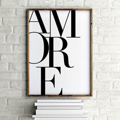Black and white typographic art print reading Amore - The Italian word for Love. Awww go on you know you love it :)  Printed on a heavy weightacid freestock with archival pigments for colour and image integrity. The end result is a very high quality professional print witha smooth matte finish. A beautifulprint that ismade to last.  This listing is for the print only, your item will be unframed.   **** COPYRIGHT NOTICE ****  This original Cloud Walker Studios design has been taken by…