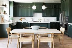 """cabinets painted in edward dunn's """"black spruce"""" make the light dining area pop..."""