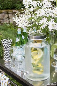 Love this simple outdoor bar cart / beverage station