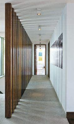 nice touch for the corridor.. granite floor tiles and fixed wooden poles to form a screen/ wall