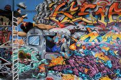 Graffiti artist Eduard Kasper works on his contribution to a joint graffiti project beneath the Theodor Heuss Bridge in Wiesbaden Mainz-Kastel, Germany, June (EPA/FREDRIK VON ERICHSEN) Graffiti, Baby Cheetahs, Saint George, Artsy Fartsy, Photo Galleries, Artist, Projects, Bridge, Germany
