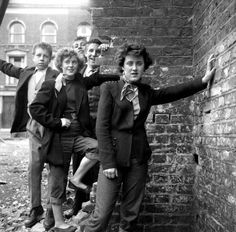 Rose Hendon and Mary Toovey pose with unknown young Teddy Boys in Southam Street. Photo by Ken Russell.