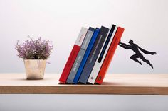 Superhero Guarding Your Favorite Books: Exquisite Bookends by Artori Design