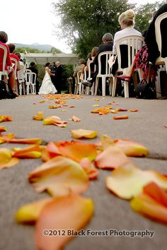 Wedding Flower petals down the aisle at the Briarhurst Manor in Manitou Springs, Colorado. This is a fall wedding theme. Colorado Springs wedding photography by Black Forest Photography http://www.blackforestphoto.com #ManitouSpringsWeddings #BriarhurstManorWeddings