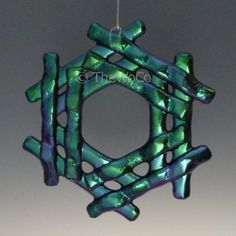 This bid is for one snowflake, from the cool tones family of black iridized glass. Fused snowflake developed and formed by me, and arrives in its own decorative keepsake gift box. Ready to hang as an ornament or sun catcher from clear floss. Each Snowflake Sold Separately. The iridized