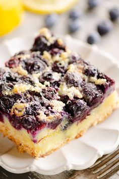 Blueberry lemon custard bars are a perfect sweet summer treat! Fresh blueberries are layered over a sugar cookie crust and a rich and creamy custard for an amazing dessert. Blueberry Lemon Recipes, Healthy Blueberry Desserts, Lemon Dessert Recipes, Sweet Recipes, Delicious Desserts, Cake Recipes, Summer Desserts, Summer Recipes, Lemon Custard