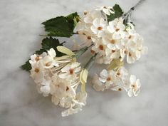 Vinitage 1950s millinery flower bunch tiny white flowers yellow centers + leaves