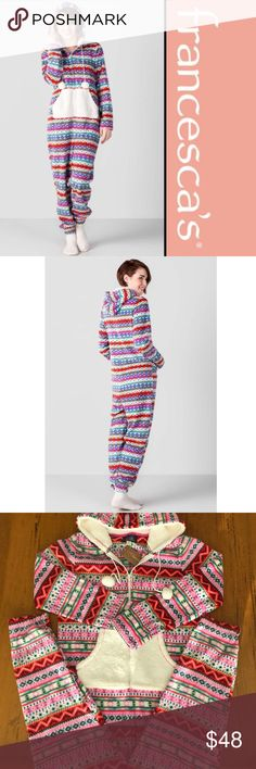 """Francesca's fleece pj onesies A colorful pattern finished with a hood and Pom poms. Super soft and comfortable! New with Tag!  59"""" length from shoulder to hem 40"""" chest 42"""" waist 29"""" inseam PRICE IS FIRM! Francesca's Collections Intimates & Sleepwear Pajamas"""