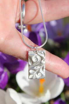 Floral pendant with embossed silver leaves by littlesilverhedgehog