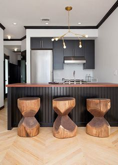 dark gray cabinets and island against white walls.