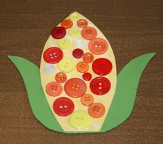 Button decorated corn on the cob - great for fall bulletin boards etc...