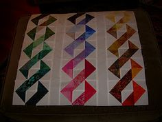 Another HST idea: DNA quilt. Would really look great in brights on black ... hmmm .... :-)