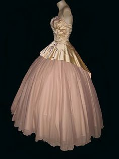 "Here is a beautiful ball gown of pink silk and lace with heavily detailed beading at the bodice designed by the legendary Edith Head. Jane Wyman wore this gown in the 1951 Paramount film ""Here Comes the Groom"". Wyman starred opposite Bing Crosby in this musical comedy. Jane Wyman was also remembered as being the first wife of Ronald Reagan."