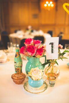 Roses in a vintage jug - wedding table centre pieces