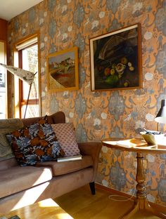 Marthe Armitage's sitting room decorated with her Gardner's pattern.  The hand made lamp with 'dunce's cap' shade behind the sofa was designed by her late husband.