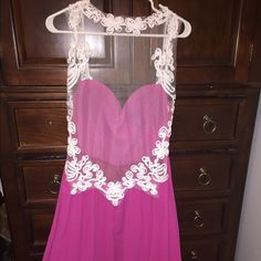Magenta Prom Dress Beautiful brand new backless magenta dress! I ordered it as a small but it's more like a medium size 6-8 :) Dresses Prom