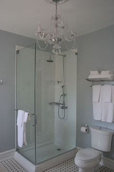 enclosed shower carrera marble vanity and European fittings.