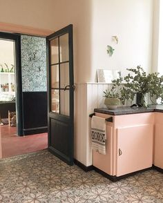 pink cabinets black