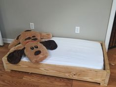 Dog bed made from crib mattress.