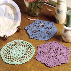"""Miniature Doilies Thread Crochet ePattern - Add a quaint decorative touch to your home with these miniature doilies. Their small size is just right for dressing up little spaces on a bureau top or a what-not shelf. Our designs are crocheted using bedspread weight cotton thread (size 10) and a size 8 (1.50 mm) steel crochet hook. Number of Designs: 3 Approximate Design Size: 5-1/2"""" to 5-3/4"""" diameter"""