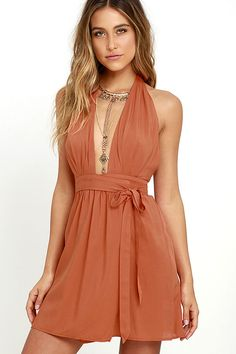 There are endless occasions that call for the arrival of you in the Positively Perfect Burnt Orange Wrap Dress! Soft woven rayon swings from an elasticized halter neckline, with wrapping triangle bodice that carries into the A-line skirt. Open back and tying sash belt.