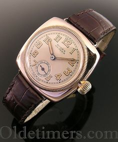 A rare early 9ct rose gold cushion vintage Rolex Oyster watch, 1920s