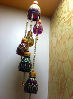 Wind chimes made out of waste plastic bottles - Simple Craft Ideas Water Bottle Crafts, Plastic Bottle Crafts, Diy Bottle, Plastic Bottle Tops, Reuse Plastic Bottles, Craft From Waste Material, Crafts To Make, Diy Crafts, Diy Wind Chimes