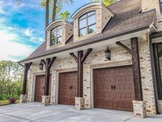 Create a rustic but elegant exterior by combining all the right elements: Dark timbers and stained triple garage doors perfectly accent Pine Hall Oyster brick. Stone Exterior Houses, Rustic Exterior, Craftsman Exterior, Dream House Exterior, Exterior House Colors, Stone Houses, Exterior Design, Stained Brick Exterior, Brown Brick Exterior