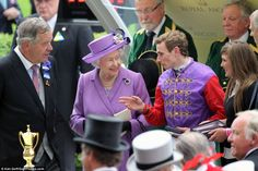 Queen Elizabeth II with her jockey before they accept the Gold Cup at Royal Ascot 6/20/2013