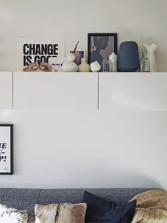 Storage over the sofa also served as a display ledge