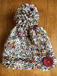 Caracol Button Hat by Kaity Fraker | malabrigo CAracol in Salpicado