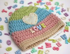 Make this Love Button Crochet Hat with Vanna's Choice! Free pattern by Repeat Crafter Me!