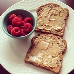 Cinnamon Raisin Ezekiel Toast with Peanut Butter and Raspberries :)