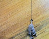 FREE SHIPPING   A Beautiful Jam - A Single Hippie Chic Inspired Feather and Reclaimed Wooden Bead Shoulder Duster... by rebellionheir((s)). $9.00, via Etsy.