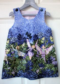 Handmade, vintage inspired pinafore style dress. This beautiful flower fairy fabric has a subtle glitter finish. This dress looks great on its