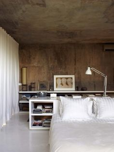Rustic looking walls and ceiling makes the room more masculin.