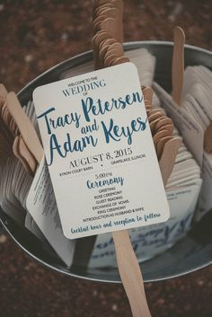 Ceremony programs were printed on handheld fans. Venue: Byron Colby Barn Event Coordinator: Events by City Sisters