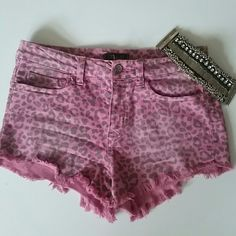 Pink denim shorts Pink and black cheetah print high waisted denim shorts. Distressed look with fringe on bottom and has faded look. (Purchased that way) Klique B Jeans