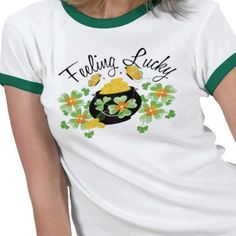 "This cute St. Patrick's day design features a pot of gold surrounded by shamrocks and the caption ""Feeling Lucky."" $26.50 #zazzle #stpatricksday #tshirt #shirt #teeshirt #potofgold #feelinglucky #cute #shamrocks"