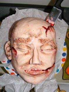 This lady is so awesome-- she made a dead head out of cake for a Hallowe'en party.  Awesome and SICK!