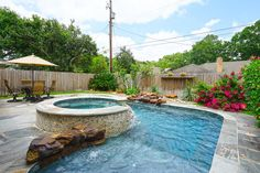 5926 YARWELL. Fabulous resort style backyard features sparkling pool/spa with rock water feature. Pool features self cleaning system. Surrounded by gorgeous flagstone, lush landscaping & zero visibility privacy fence. Wonderful for relaxing & entertaining! Bernstein Realty, Houston Real Estate.