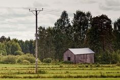 An old barn by the fields at the edge of the forest in the rural Finland. Travel Pictures, Travel Photos, Places Around The World, Around The Worlds, Old Barns, Agriculture, Finland, The Good Place, Cabin