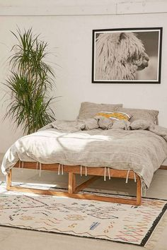 love this bed frame that's minimal, boho, and unique without trying too hard.