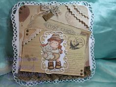For my project I have made a card, the card base is made using my new Spellbinders grand dies again, the image is a stamp from Magnolia coloured in with Promarkers. the papers are from Kaiserkraft and the die cut frame is from Marianne Design dies. I have then just decorated with some brown lace, some cream crochet lace, brown pearls, a postcard charm and a little bow tied from organza ribbon.