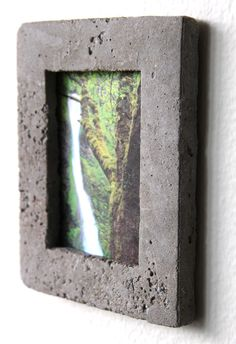 DIY: CONCRETE PICTURE FRAME- You could put a less expensive frame into the cement in the back to have glass