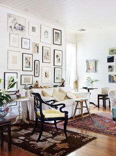 The Sydney home of artist Cressida Campbell. Collection of small paintings, salon hung in the loungeroom. Photo - Sean Fennessy, production – Lucy Feagins / The Design Files. Dining table in open pla My Living Room, Home And Living, Living Room Decor, Living Spaces, A Frame Cabin, The Design Files, Rooms Home Decor, White Decor, Vintage Decor