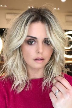 Bob haircuts are one of the most popular styles these days and it appears as though they will never go out of style. One of the trendiest looks is the inverted or stacked bob as it is the most flattering. - Shoulder-Length Tousled Bob