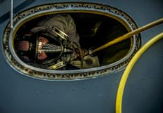 Airman 1st Class Nicholas McKinney looks up from the inside of a C-17 Globemaster III fuel tank during a routine training exercise March 7, 2013, at Joint Base Charleston, S.C. Fuel systems repair Airmen maintain the fuel cells and tanks by removing, repairing the cells and tanks.