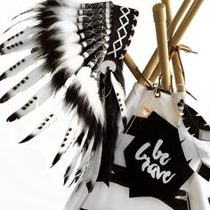 A close up of this amazing Indian headdress from @house_of_lavargo and be brave wall flag from @elevenpoundsix #monochrome #blackandwhite #feathers #headdress #teepee #boysroom #playroom #interior #decor